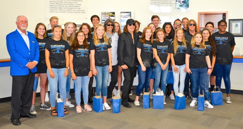 Mike Collins, General Manager Of Sterling McCall Honda (far Left) Poses  With Foreigner And The Woodlandu0027s John Cooper School Choir.